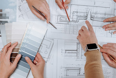 People discussing floor plan for shop fitout